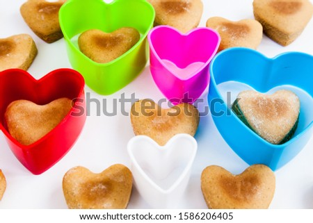 Heart shaped cookies on a white background with plastic shapes #1586206405
