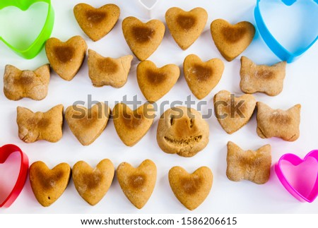 Heart shaped cookies on a white background with plastic shapes #1586206615