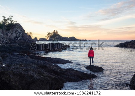Wild Pacifc Trail, Ucluelet, Vancouver Island, BC, Canada. Adventurous Girl Enjoying the Beautiful View of the Rocky Ocean Coast during a colorful morning sunrise. Concept: Travel, adventure, freedom #1586241172