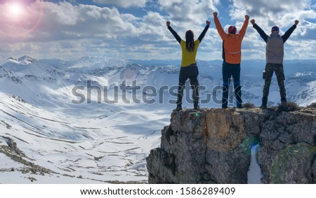 successful mountaineering team achieving the goal of winter climbing #1586289409