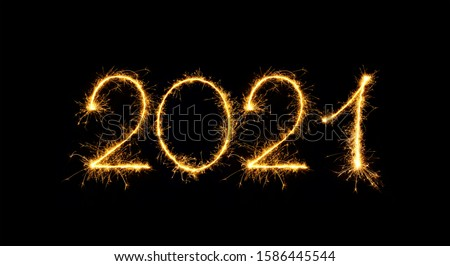 Happy New Year 2021. Sparkling burning numbers Year 2021 isolated on black background. Beautiful Glowing golden overlay object for design holiday greeting card, billboard and Web banner #1586445544