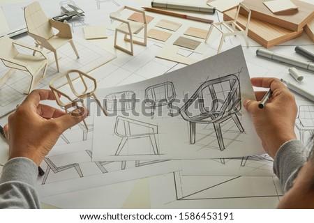 Designer sketching drawing design development product plan draft chair armchair Wingback Interior furniture prototype manufacturing production. designer studio concept .                            #1586453191