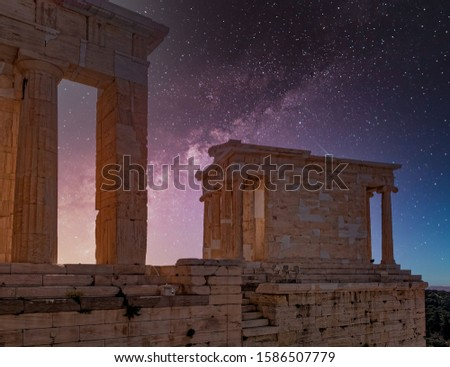 Athena Nike ancient temple illuminated by starry night sky, Athens acropolis Greece #1586507779