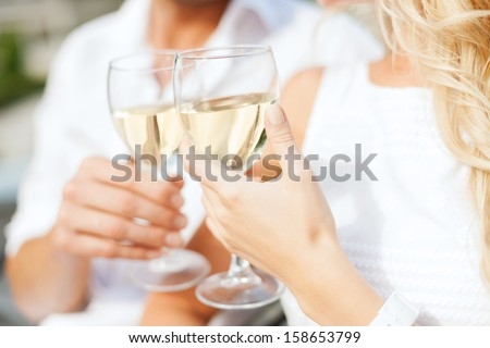 summer holidays and dating concept - couple drinking wine in cafe in the city #158653799