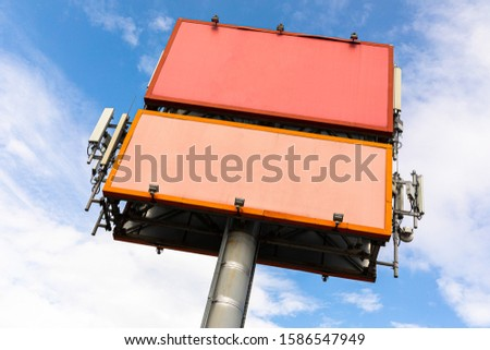 Large advertising standб advertising banner on sky background #1586547949