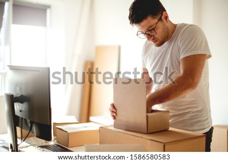 Young Man Working in Delivery service #1586580583