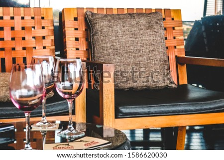 empty chair, empty wine glasses, after friends have been and gone #1586620030