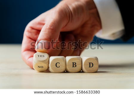 Conceptual image of CBD legalization and use. Royalty-Free Stock Photo #1586633380