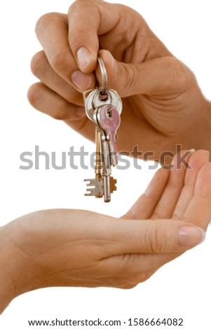 Man handing woman set of keys, close-up of hands, side view, cut out #1586664082
