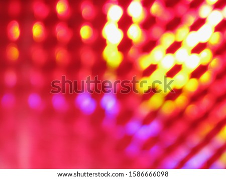 An abstract image of purple, pink and yellow lights #1586666098