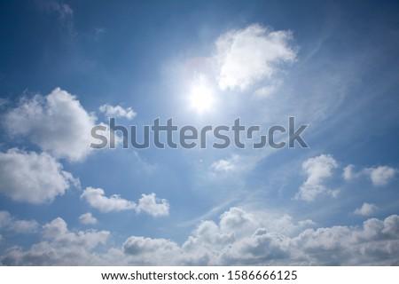 Sun and clouds in blue sky #1586666125