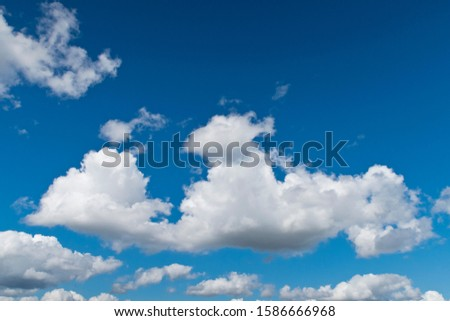 Blue sky with fluffy white clouds #1586666968