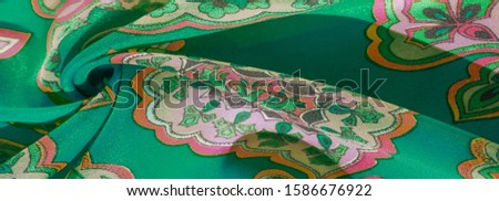 texture, background, multicolored silk fabric with a pattern of patterns on a green background, jacquard pattern #1586676922