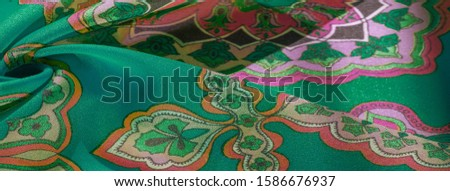 texture, background, multicolored silk fabric with a pattern of patterns on a green background, jacquard pattern #1586676937