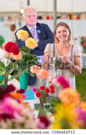 Judge Awarding Trophy At Flower Show #1586682913