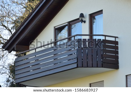 Wooden balcony of a residential building in a residential area of a European city #1586683927