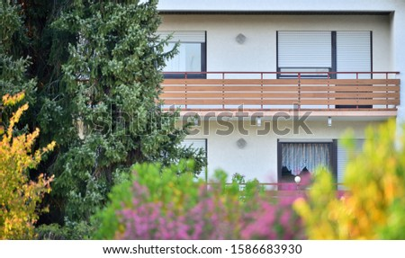 Wooden balcony of a residential building in a residential area of a European city #1586683930