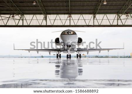 Pilots in private jet in hangar #1586688892