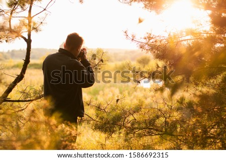Man silhouette photographer and camera taking photo of sunset. Travel. Lifestyle hobby concept adventure active vacations outdoor. #1586692315