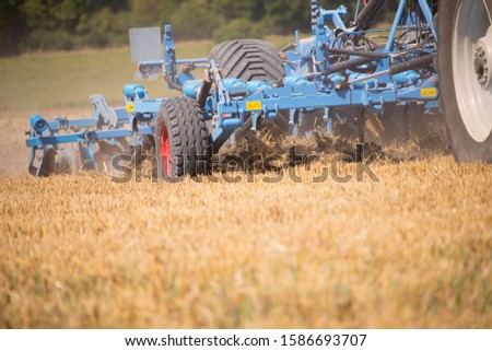 Close Up Of Tractor Ploughing Field Using Disc Plough #1586693707