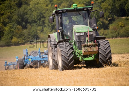 Tractor Ploughing Field Using Disc Plough #1586693731