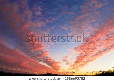 Dramatic sunset sky with pink clouds #1586693782