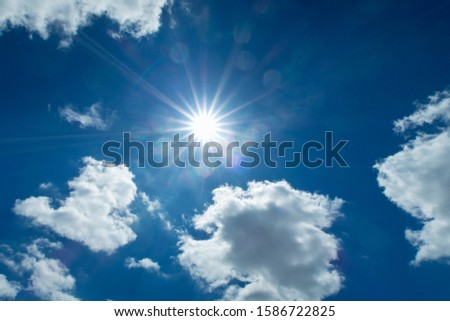 Sun Shining With White Clouds Against Blue Summer Sky #1586722825