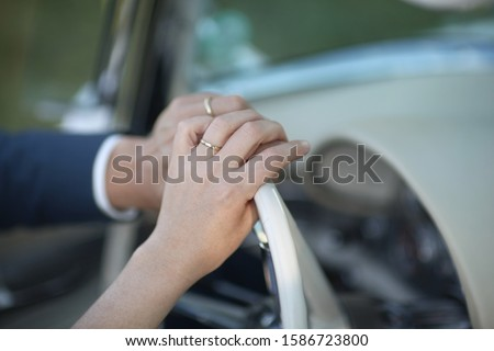 Bride And Grooms Hands On Car Steering Wheel On Wedding Day #1586723800