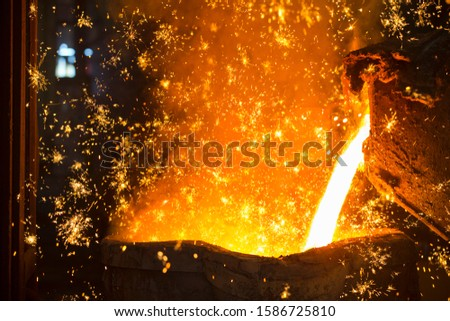 Shower Of Sparks As Molten Metal Is Poured In Steel Foundry #1586725810