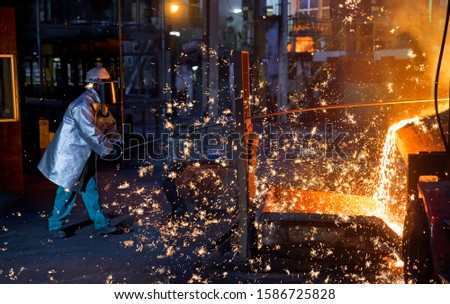 Shower Of Sparks As Molten Metal Is Poured In Steel Foundry #1586725828