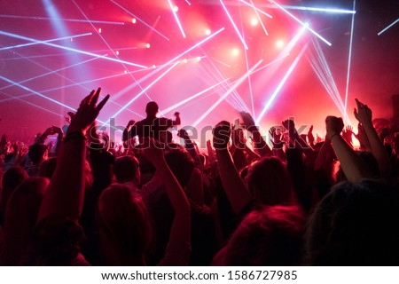 View Of Fans Enjoying Rock Concert With Light Show #1586727985