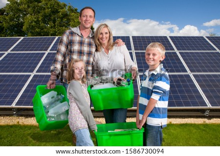 Family With Household Recycling Standing By Solar Panels #1586730094