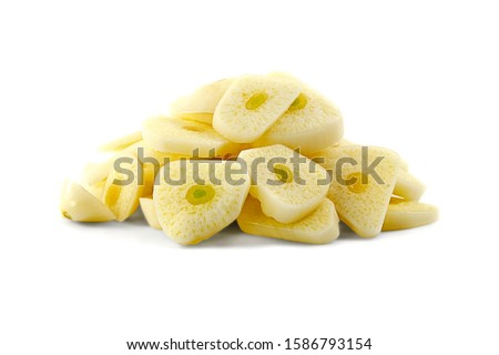 Pile of chopped garlic isolated on a white background. Finely chopped garlic on a white background. Sliced garlic cloves on a white background. Chopped garlic isolated on a white background. #1586793154