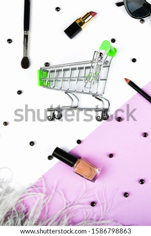 Basket and womens accessories. Womens accessories, on a pink background pastel. Beauty and fashion concept. Top view, flat minimalism. #1586798863