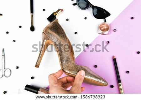 Womens shoes and accessories. Basket and womens accessories. Womens accessories, on a pink background pastel. Beauty and fashion concept. Top view, flat minimalism. flat lay #1586798923