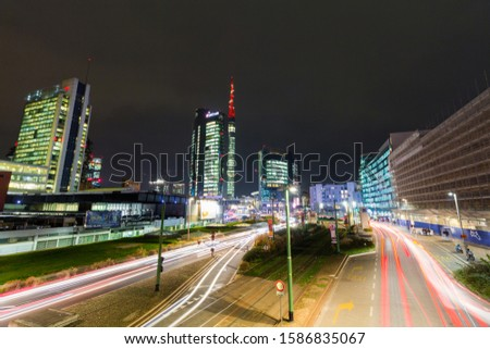 MILAN, ITALY - DECEMBER 11, 2019: Panoramic night view with modern skyscrapers in Porta Nuova business district  in Milan #1586835067