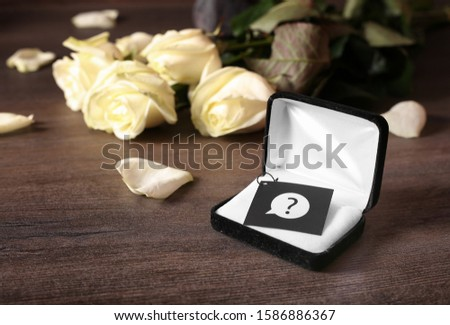 Waiting for proposal to get married. Will you marry me. Gift and flowers as a manifestation of love and feelings. Conceptual vision of creating a family. Why he does not call to marry.  #1586886367