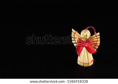 figures of woodden angel isolated on black background Royalty-Free Stock Photo #1586918338