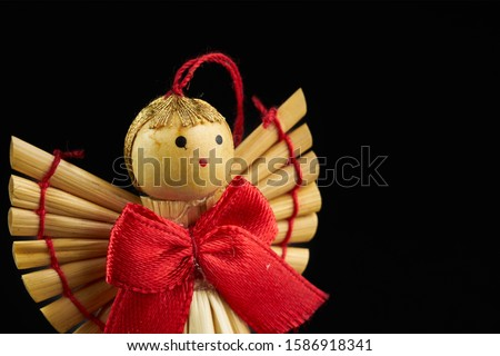 figures of wooden angel isolated on black background Royalty-Free Stock Photo #1586918341