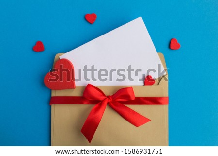 Blank white paper for text, envelope and red hearts on the blue background. Copy space. Top view. #1586931751