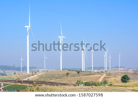 Many windmill for renewable energy,wind power for electric current with blue sky and copy space #1587027598