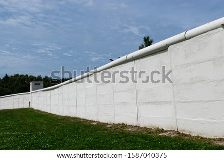 THE BERLIN WALL AS IT PASSES THROUGH THE TOWN OF MÖDLAREUTH #1587040375