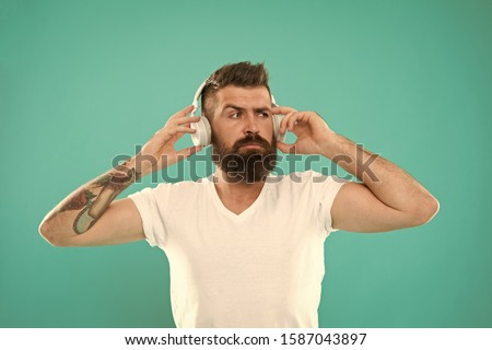 Mature hipster with beard listening music. Stylish and handsome music lover. Man in headphones. Free online music sources all work little bit differently and have many different features. Music chart. #1587043897