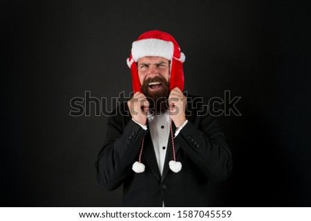 Businessman Santa in jacket. Christmas party concept. Feeling warmth. Funny winter hat. Business santa wish you financial growth. Business corporate. Man with beard in smart suit and Santa hat. #1587045559