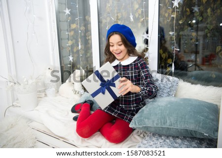 Surprise inside the box. Surprised child open gift box. Christmas surprise. Little girl keep mouth opened of surprise. Surprise from Santa Claus. Feast day of Saint Nicholas. Boxing day. New year. #1587083521