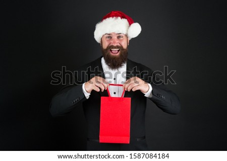 Dont miss our december sale. Happy santa boss hold shopping bag. Christmas sale and discount. Xmas special. Seasonal sale. Low prices. Big savings. Enjoy reduction and sale. Want a gift, copy space. #1587084184