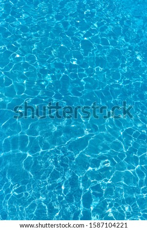 Texture of water surface. Overhead view, Swimming pool bottom caustics ripple and flow with waves background. #1587104221