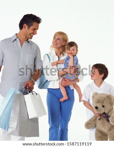 Parents and two children carrying shopping bags and a teddy bear #1587119119
