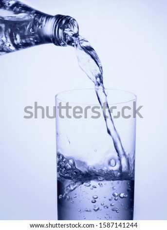 View of water being poured into a glass #1587141244