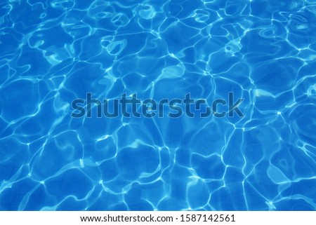 High angle view of sun patterns on water in a swimming pool #1587142561